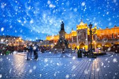 Old town of Krakow on a cold winter night with falling snow. Poland stock photo