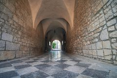 Old town of Krk, Stone arc passage at Krk Cathedral. Famous touristic Krk town on Krk island, Croatia, Europe. Krk is a Croatian island in the northern Adriatic Stock Photos