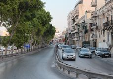 Old town left-hand traffic. Old streets of Maltese Gzira old city with traffic in early evening Royalty Free Stock Photography