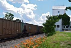 Old Town Lenexa Train Depot. With a train passing through on a beautiful sunny day Royalty Free Stock Images