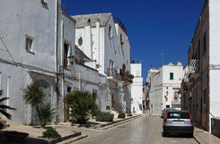 In the old town of Locorotondo, Italy. Street in the old town of Locorotondo, Puglia, Italy Royalty Free Stock Photography