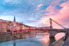 Old town of Lyon at gorgeous sunset, France. Saint Georges church and footbridge across Saone river, Old town with Fourviere cathedral at gorgeous sunset in Lyon