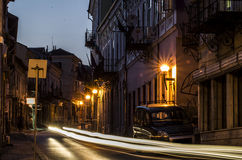 Old town main street at night. Long exposure, street lights and old buildings Royalty Free Stock Images