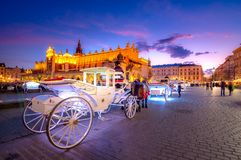 Old town market square of Krakow, Poland. With horse carriages stock image