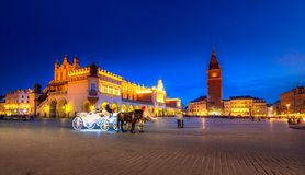 Old town market square of Krakow, Poland. With horse carriages stock images