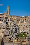 Old town. Matera. Basilicata. Apulia or Puglia. Italy. Old houses and bell tower of the Cathedral of Maria Santissima della Bruna. Matera. Basilicata. Apulia or stock images