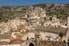 Old town. Matera. Basilicata. Apulia or Puglia. Italy. Old houses in the sassi and Piazza Madonna de Idris at the far top center. Matera. Basilicata. Apulia or royalty free stock photography