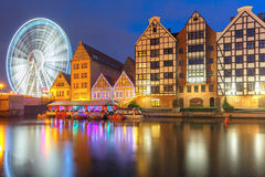 Old Town and Motlawa River in Gdansk, Poland. Ferris wheel with water reflection at Trade fair St Dominic in Old Town of Gdansk at night, Poland Stock Photography