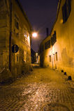 Old town narrow street. Night falls over an narrow street of Hermanstadt (Sibiu), Romania stock photo