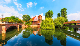 Old Town in Nuremberg, Germany. Scenic summer view of the German traditional medieval half-timbered Old Town architecture and bridge over Pegnitz river in Royalty Free Stock Photography