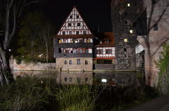 Old Town Nuremberg Half-timbered house. Night View of Half-Timbered House at the river Pegnitz in Nuremberg, Germany Stock Photo