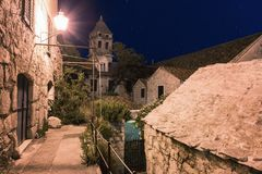Old town of Omis at night, ancient architecture illuminated by street lights, Dalmatia, Croatia. Old town of Omis at night, ancient architecture illuminated by stock photo