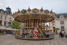 The old town in Orleans (France) with a carousel. Stock Photos