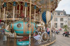 The old town in Orleans (France) with a carousel. Royalty Free Stock Image