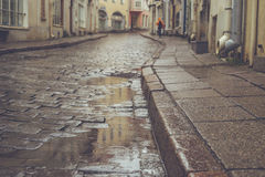 Old town pavement street on rainy day Stock Photo