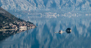 Old town Perast. Church and two islands Stock Photos