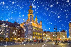 Old town of Poznan on a cold winter night with falling snow. Poland stock photography