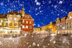 Old town of Poznan on a cold winter night with falling snow. Poland stock images
