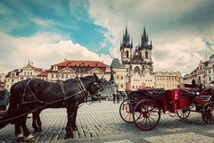 Old Town of Prague, Czech Republic. Horse carriage for tourists. Tyn Church, vintage Stock Images