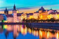 Old Town in Prague, Czech Republic. Scenic summer sunset panorama of the Old Town ancient architecture and Vltava river pier in Prague, Czech Republic stock photography