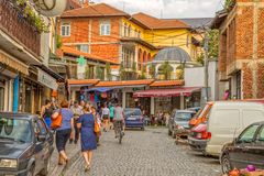 Old town in Pristina. PRISTINA, KOSOVO - JULY 29, 2014: People passing by Fatih Mosque located in the center of the old town witch is disorganized and full of Royalty Free Stock Image