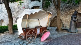 Old Town after rain Town Square  Pink umbrella on old stone blocks Medieval Old tent on wooden wheels stands the street Mo. Europa travel  Tallinn Old Town after royalty free stock images