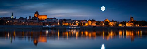 Old town reflected in river at sunset. Torun stock photography