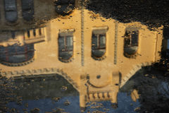 Old town  reflecting in a puddle after rain Stock Photography