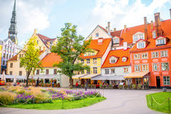 Old town in Riga. Livu square with beautiful flowerbed and buildings in the old town of Riga, Latvia Stock Photo
