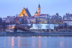 Old Town and river Vistula at night in Warsaw, Poland. Royalty Free Stock Images