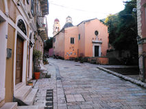 Old town. A road and a church Stock Images