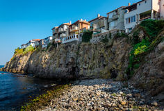 Old town on a rock cliff. At seashore Stock Images