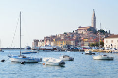 The old town of Rovinj. Rovinj, Croat - September 11, 2015: The old town of Rovinj seen from the sea. Saint Euphemia Cathedral rises above the town. Many boats Royalty Free Stock Photos