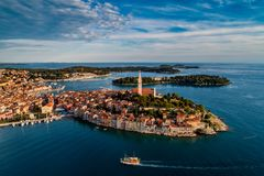 The old town of Rovinj, Istria, Cro. Beautiful Rovinj at sunset - HDR aerial view taken by a professional drone from above the sea. The old town of Rovinj royalty free stock images