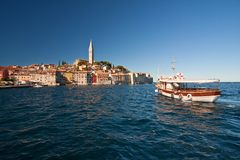 The old town Rovinj with motorboat Royalty Free Stock Photography