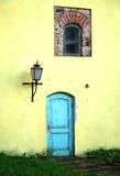 Old Town scene. A blue door on a yellow wall with authentic fragment of a red brick wall. Travel Poland Royalty Free Stock Image