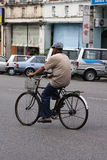 Old Town Scene. Asian Old man bicycling in an old town street Royalty Free Stock Image