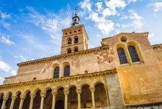 Old Town of Segovia and its Aqueduct. UNESCO World Heritageouple of the KIng penguins. Iglesia de San Esteban (San Esteban Church), Segovia, Spain royalty free stock images
