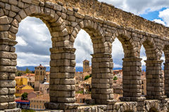 Old town of Segovia through the Roman aqueduct Royalty Free Stock Photography