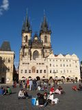 Old town square in Prague. Tourists visiting Prague in a sunny day Royalty Free Stock Photos