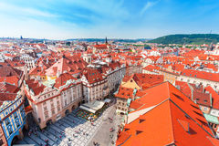 Old Town Square in Prague from Clock Tower. Many colored houses at the bottom of the square. Aerial view Stock Photography
