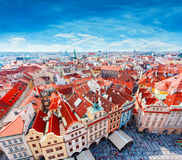 Old Town Square in Prague from Clock Tower. Many colored houses at the bottom of the square. Aerial view Stock Images