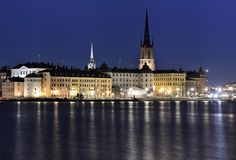 Old Town in Stockholm with the island Riddarholmen in the front at night. The oldest and original center of Stockholm build on a smale island for protections Royalty Free Stock Photography