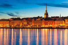The Old Town in Stockholm, Sweden. Scenic summer evening panorama of the Old Town (Gamla Stan) pier architecture in Stockholm, Sweden Royalty Free Stock Images