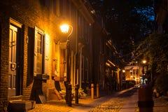 Old town stone street in Philadelphia, Pennsylvania at night time.  royalty free stock photos