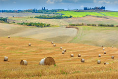 Old town and straw bales in Tuscany,Italy,Europe Stock Images