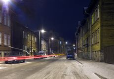 Old town street. Long exposure shot - streetlights and car passing by Royalty Free Stock Photography
