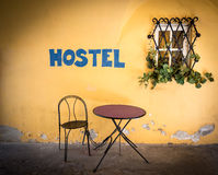 Old town street in Europe with hostel sign. Royalty Free Stock Photography
