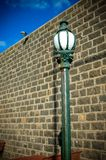 Old Town Street Lamp Post With Wall And Blue Sky Royalty Free Stock Image