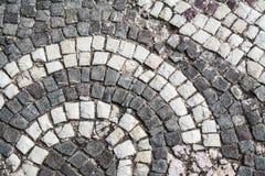Old town street paving, circle pattern tiles. Vintage rocks.  Stock Image